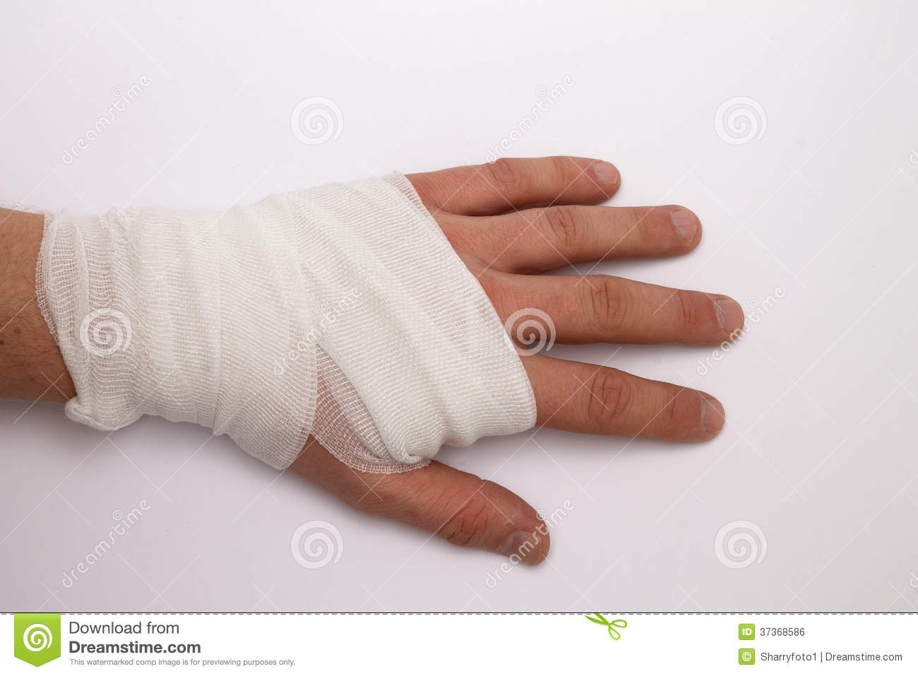 bandaged hand after accident or injury.