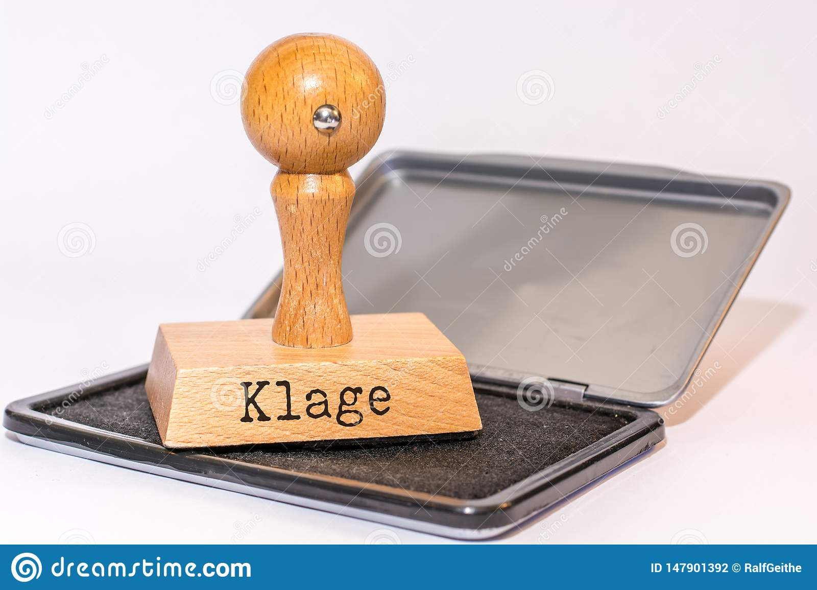 Ink pad and stamp with the German word `suit`