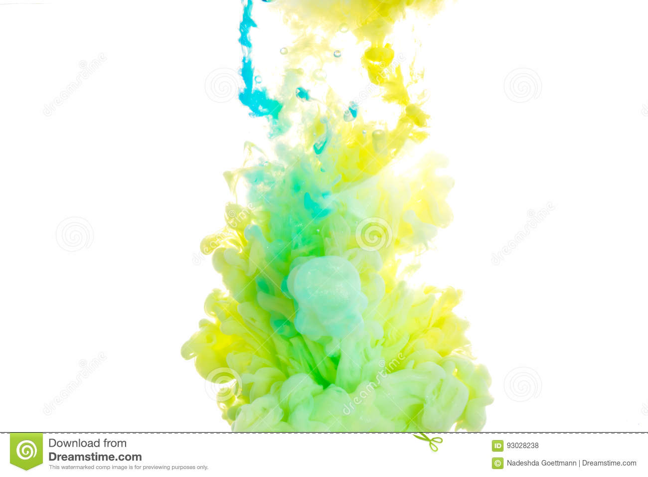 Ink. Yellow, blue, and green acrylic colors. Ink swirling in water. Color explosion
