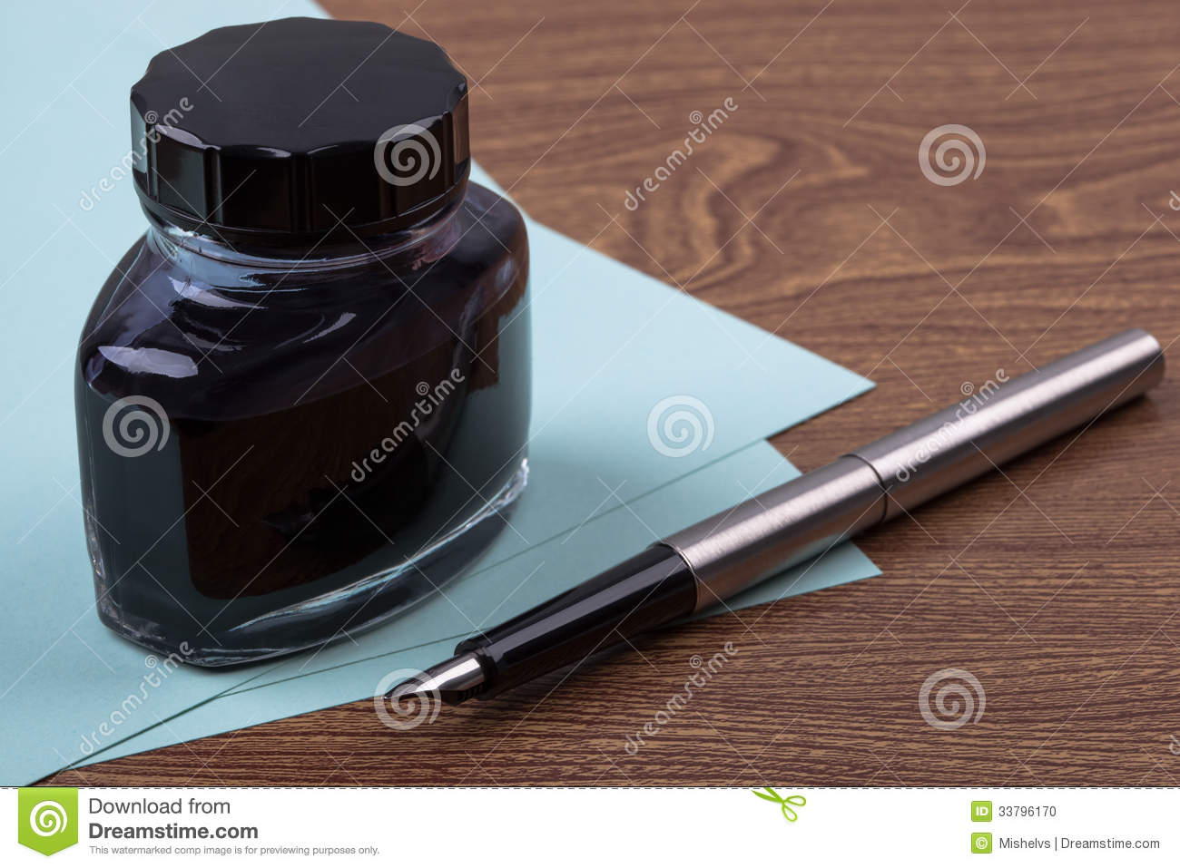 An inkwell  sheets of paper and a fountain pen on wooden texture    Fountain Pen And Inkwell