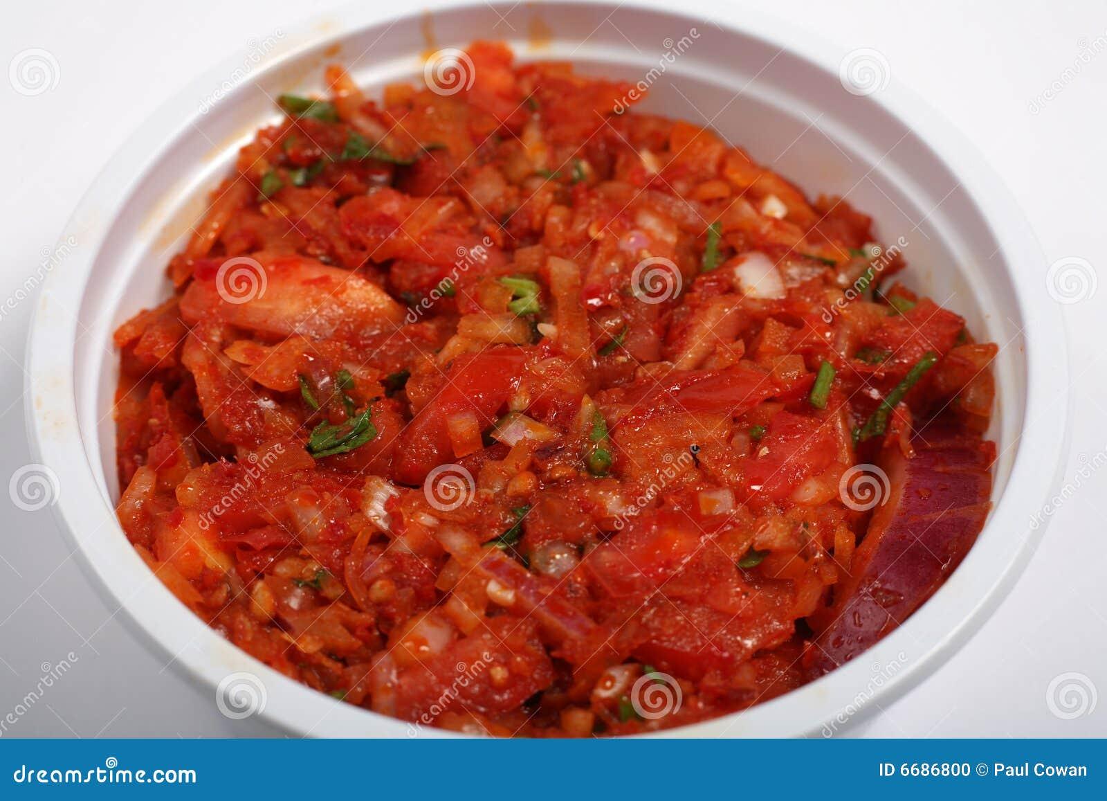 Inmersión del tomate de los chiles de la cebolla