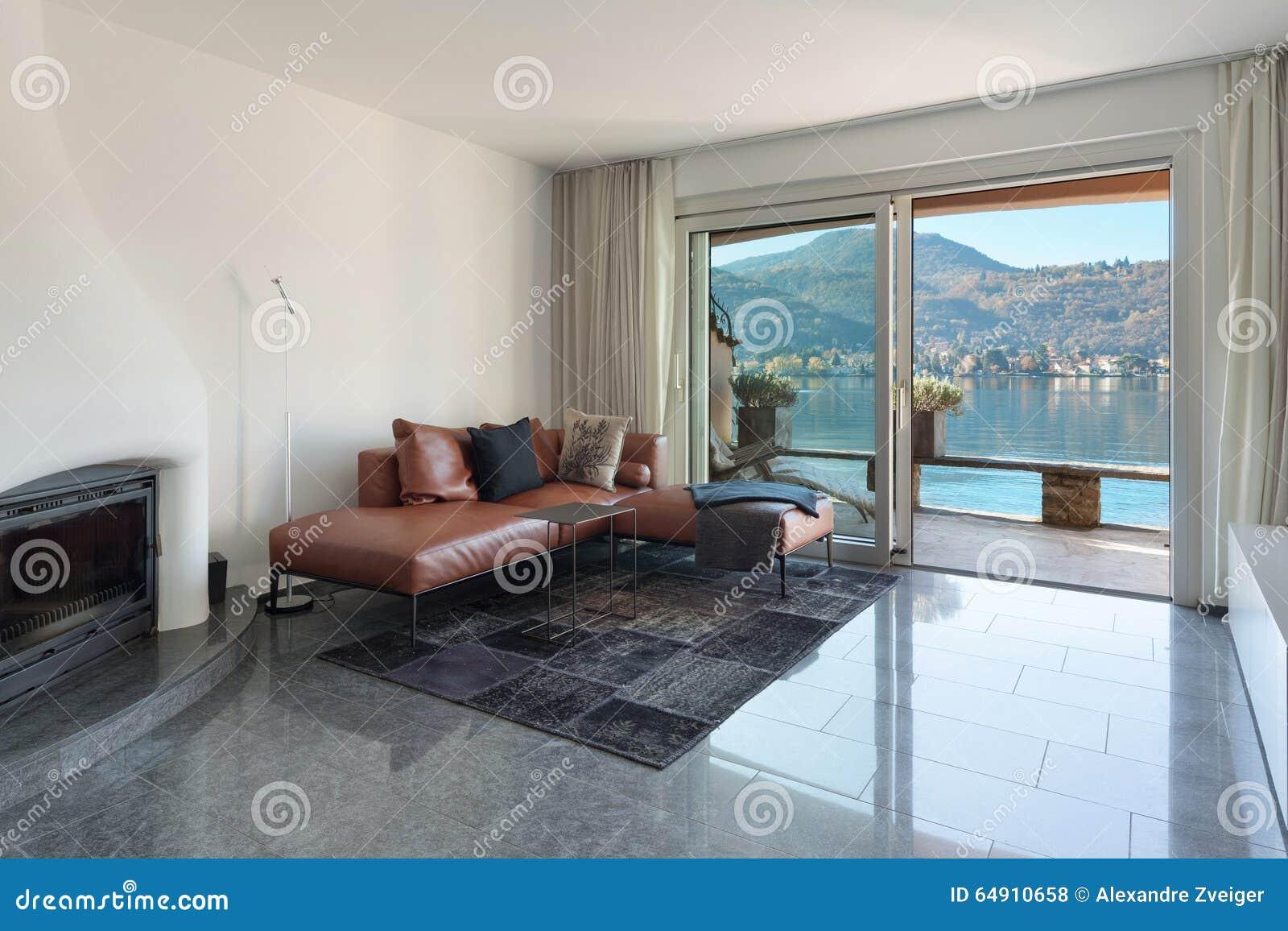 Inre av huset, modern vardagsrum arkivfoto   bild: 64910658