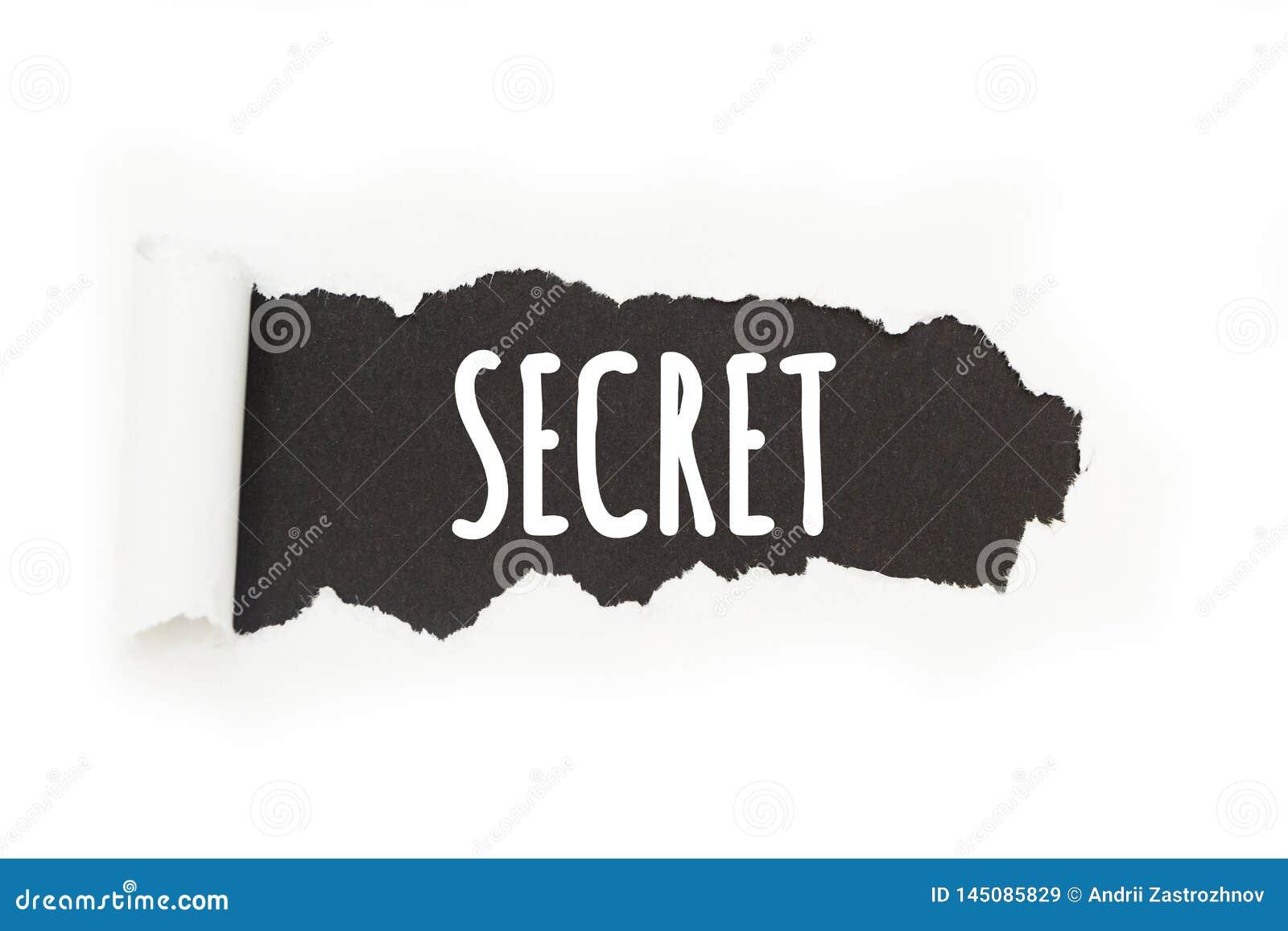 """Inscription d isolement """"secret """"sur un fond noir, rupture de papier"""