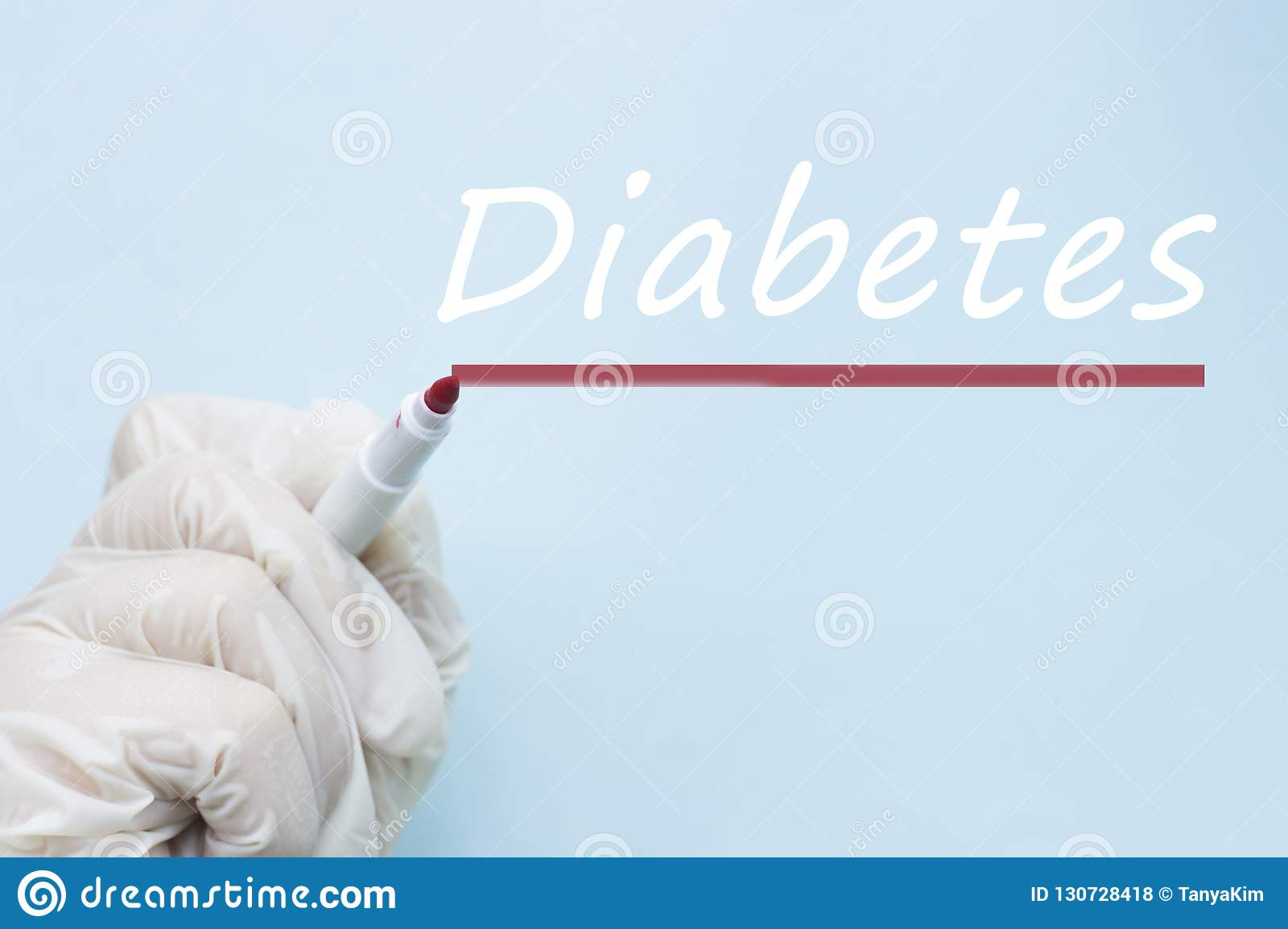 Inscription Diabetes and hand in medical glove on blue background, World Diabetes Day, medical concept