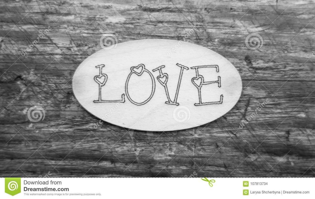 Word Of Love In Black And White On A Wooden Background Stock Photo