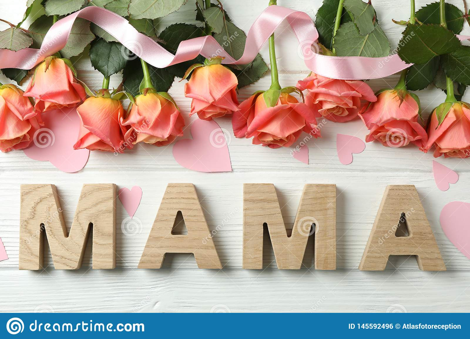 Inscription Mom with pink roses, ribbon and little hearts on wooden background