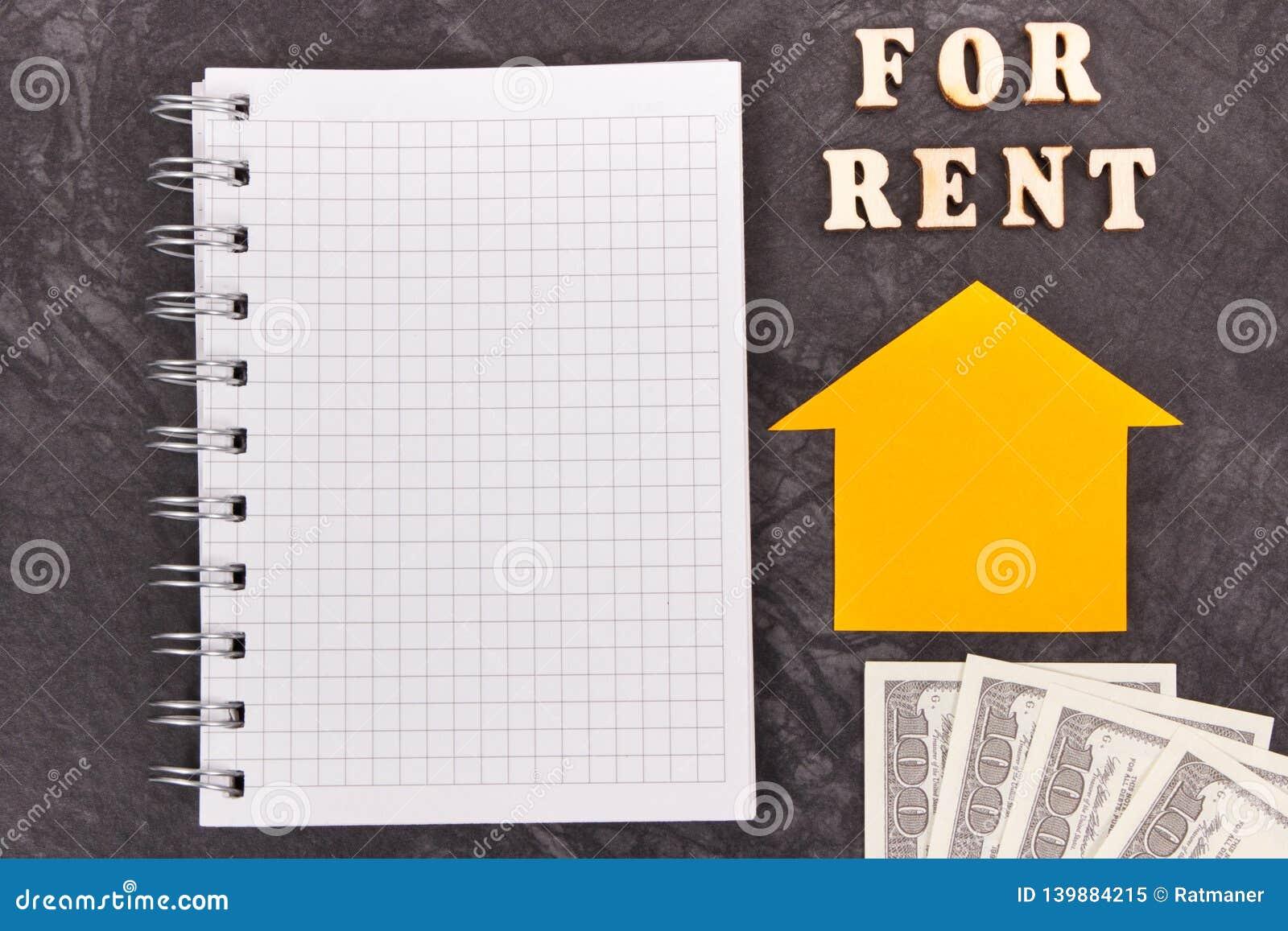 Inscription pour le loyer, les devises dollar et le bloc-notes pour des notes maison à louer ou concept plat