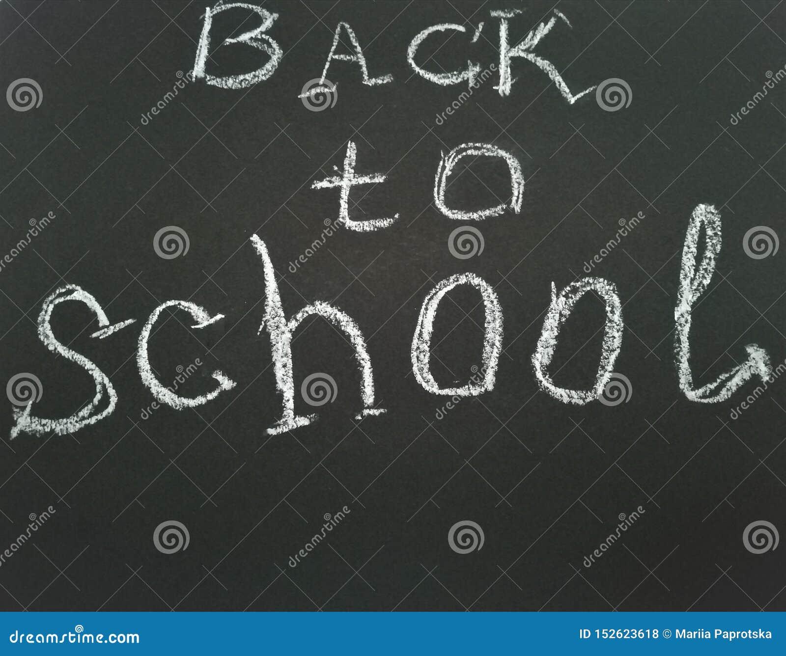 Inscription on shcool blackboard Back to school