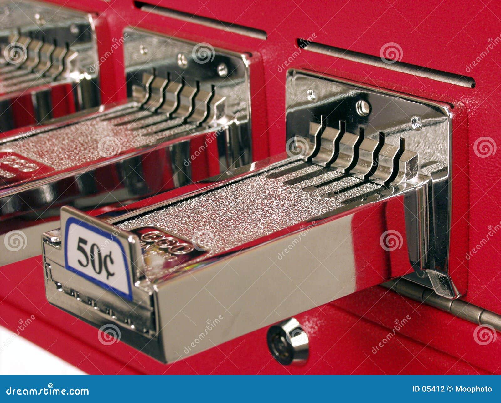 Inserisca la scanalatura di moneta $0.50 nei quarti