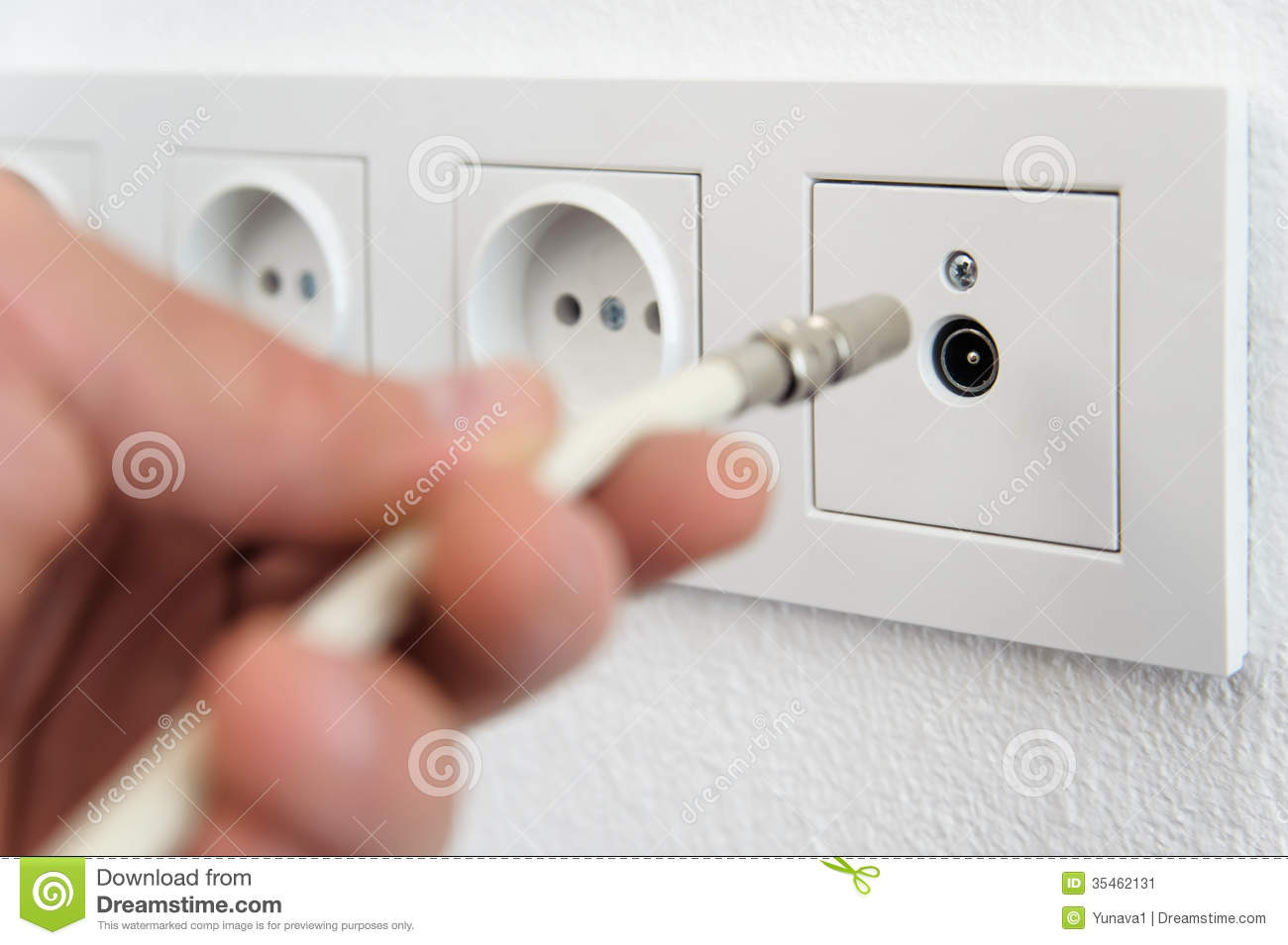 Inserts The Antenna Cable To The Tv Outlet Stock Image