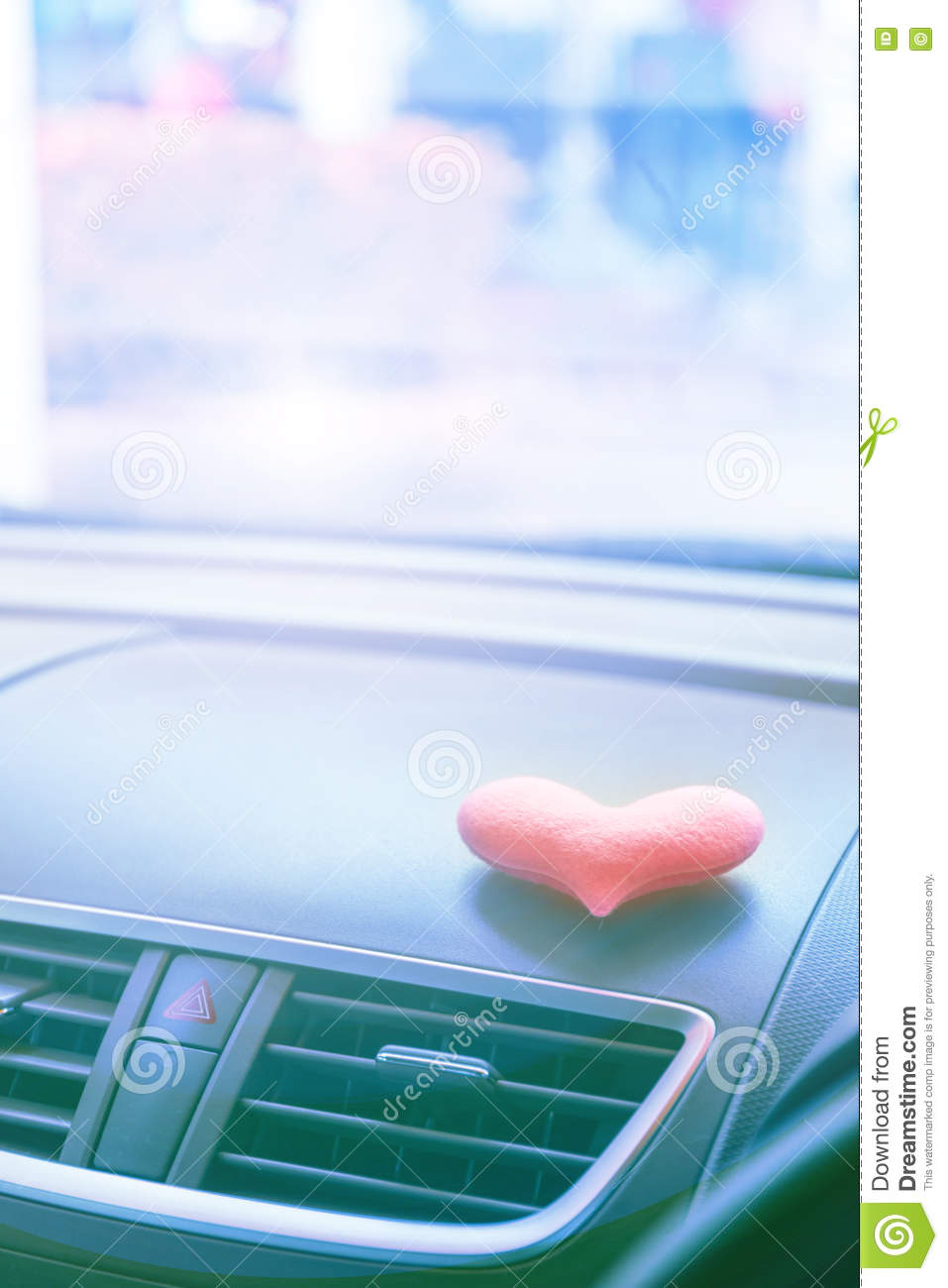 Inside Car With Pink Heart With Blue Light Filter Stock Photo