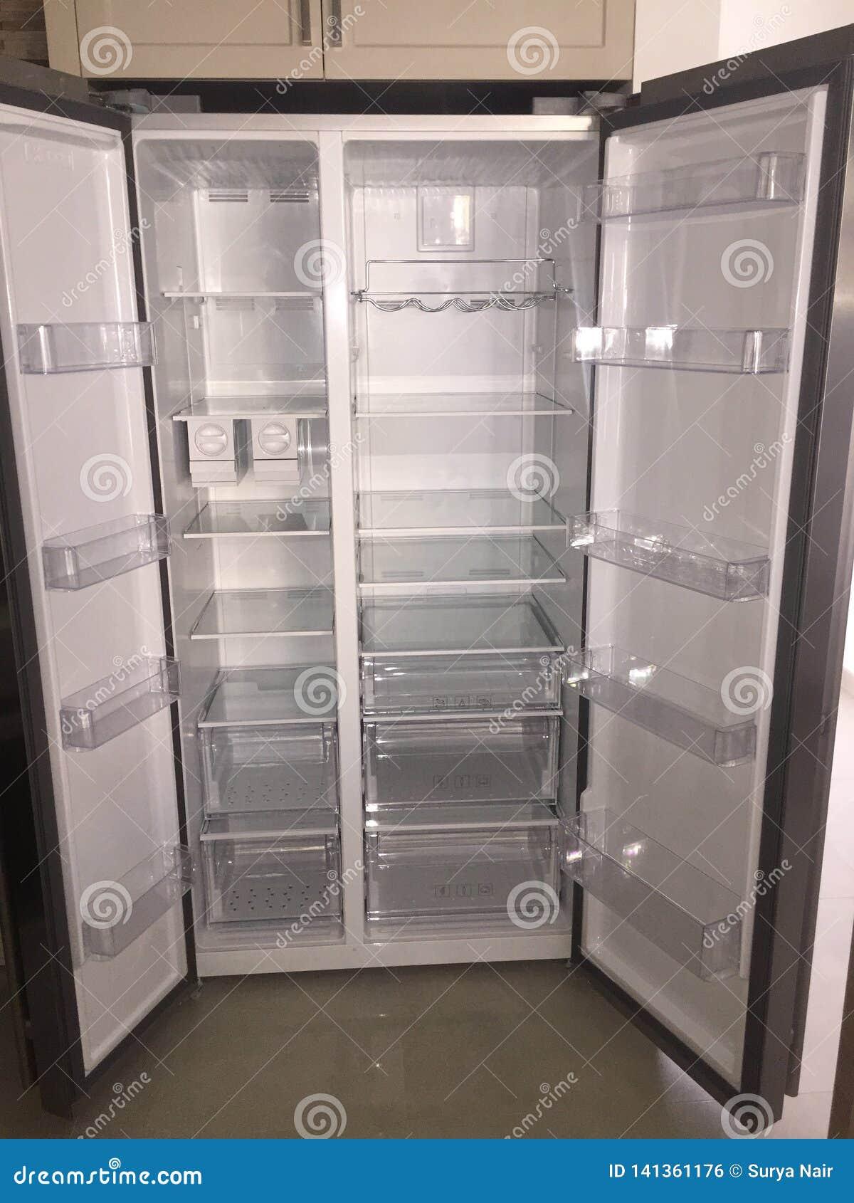 Inside of Empty Grey Double Door Fridge. Inside shelves of brand new refrigerator