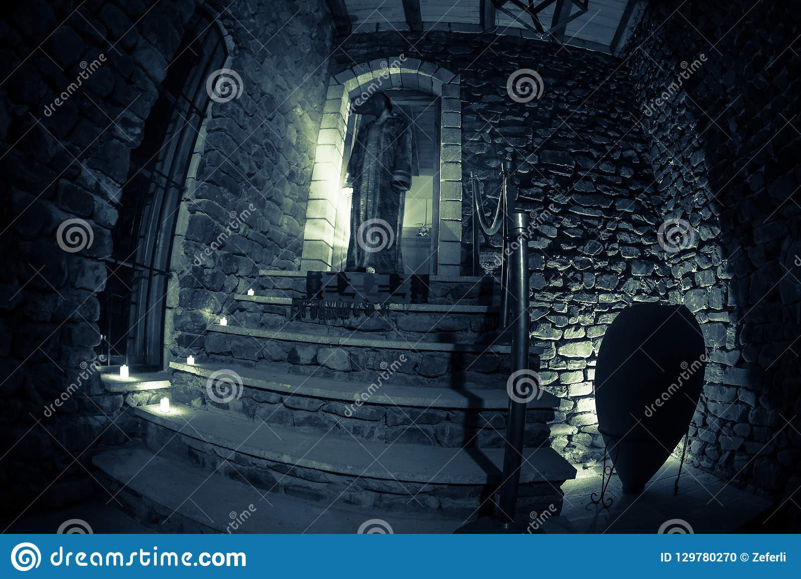 Inside Of Old Creepy Abandoned Mansion Staircase And Colonnade Silhouette Of Horror Ghost Standing On Castle Stairs To The Basem Stock Photo Image Of Horror Dark 129780270