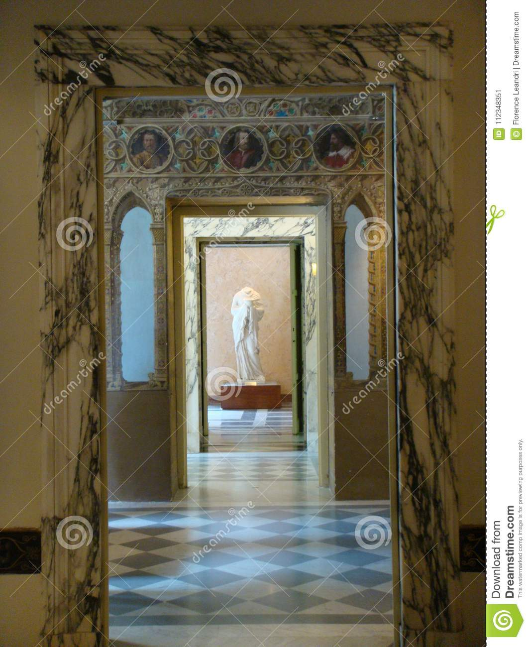 Inside of the Villa Torlonia with a corridor of marble with after all an antique statue, Rome, Italy.