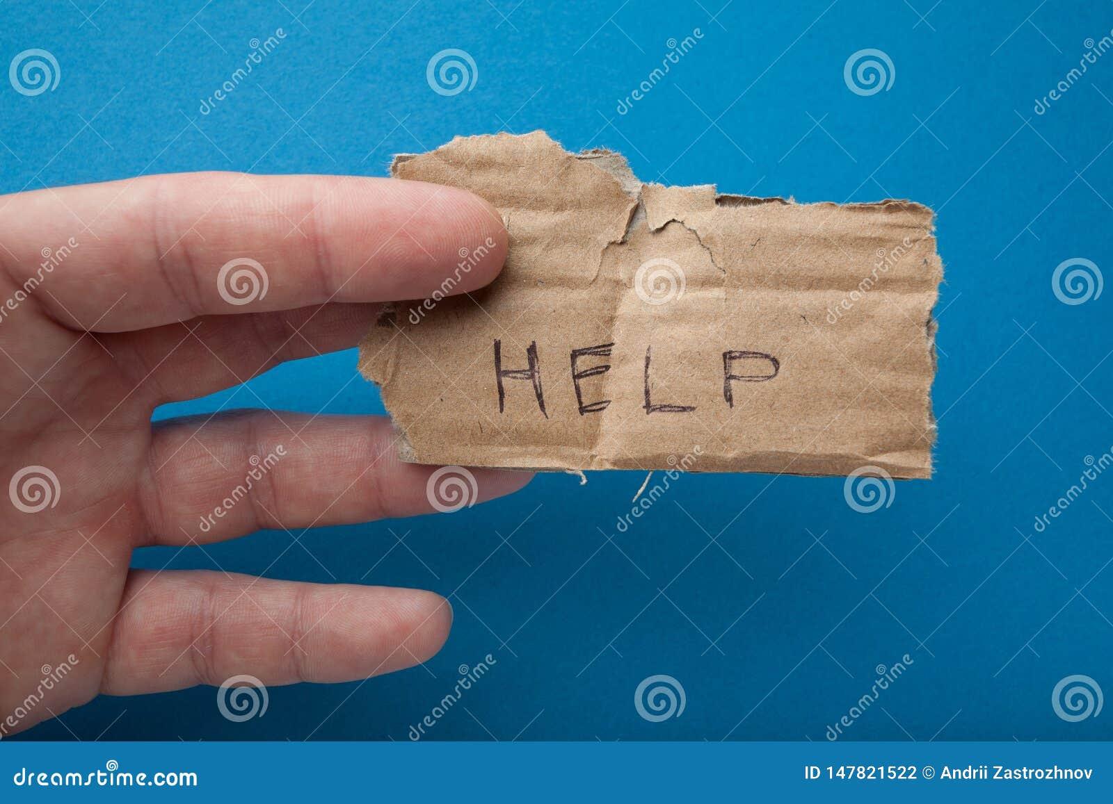 Inskriften på det gamla stycket av papp: 'Hjälp 'Armod och allmosa