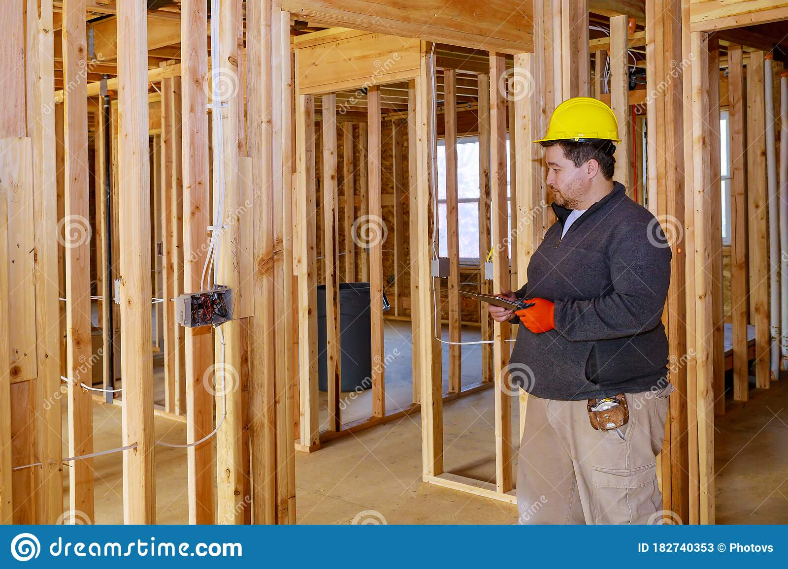 Inspector With Yellow Hard Hat Checking Electrical Wiring Inside House Stock Image Image Of Electric Electrician 182740353