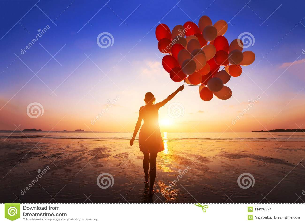 Inspiration, joy and happiness concept, silhouette of woman with many flying balloons