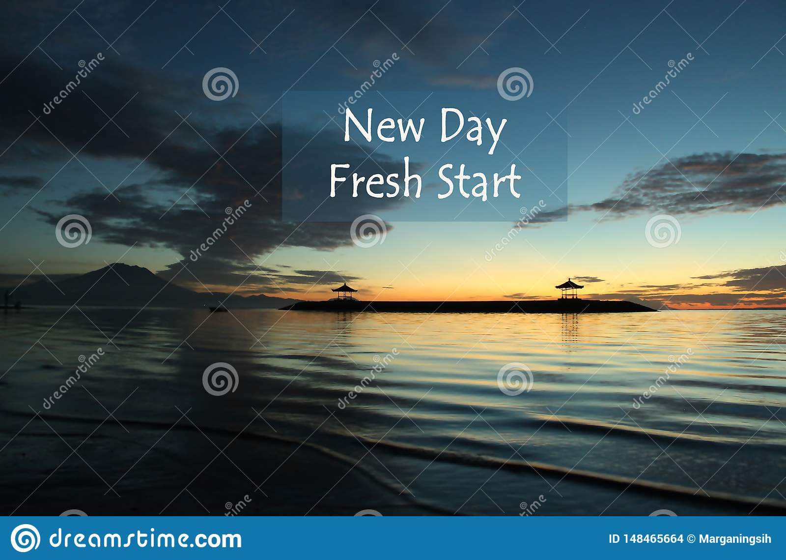 New Day Quote with blurry blue landscape background.