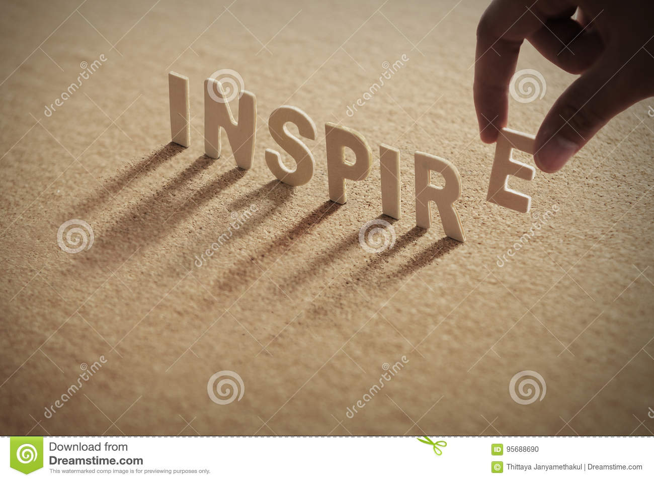 INSPIRE wood word on compressed board
