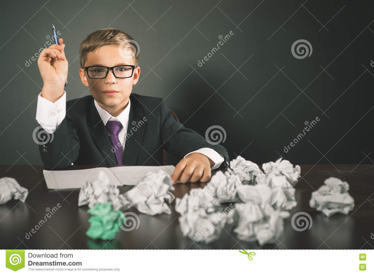 inspired school boy has a great idea stock photo   image of  inspired school boy has a great idea writing essay or exam young business  person has a good idea and writing it conceptual image copy space