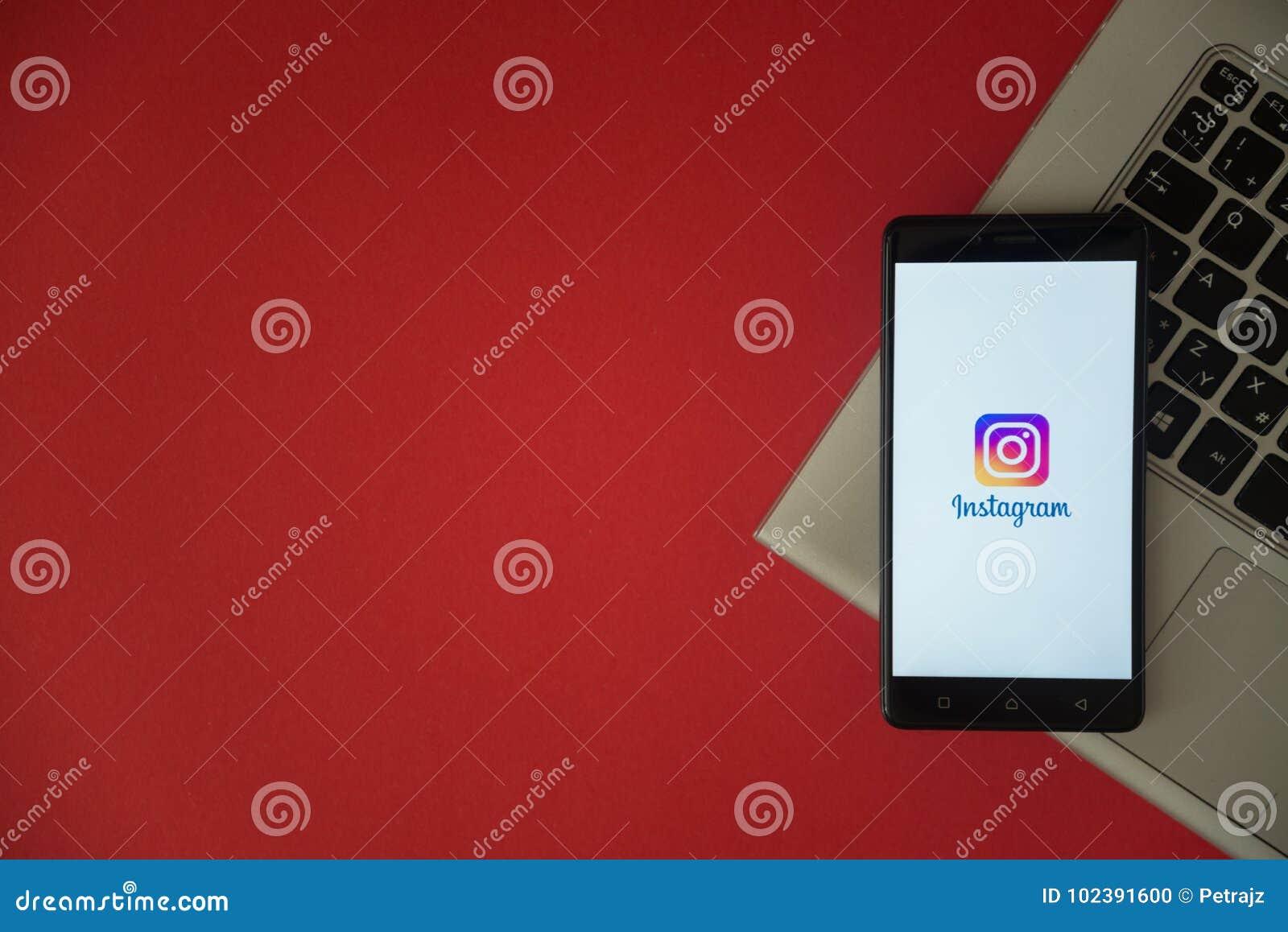 Instagram Logo On Smartphone Screen Placed On Laptop Keyboard