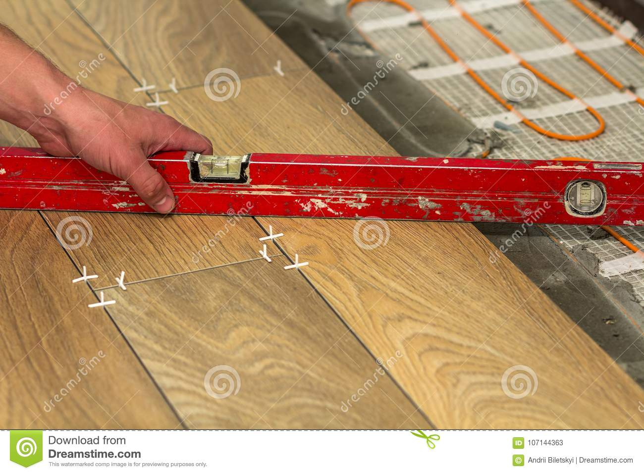 Installation of ceramic tiles and heating elements in warm tile installation of ceramic tiles and heating elements in warm tile home building royalty free stock photo download installation of ceramic tiles dailygadgetfo Gallery