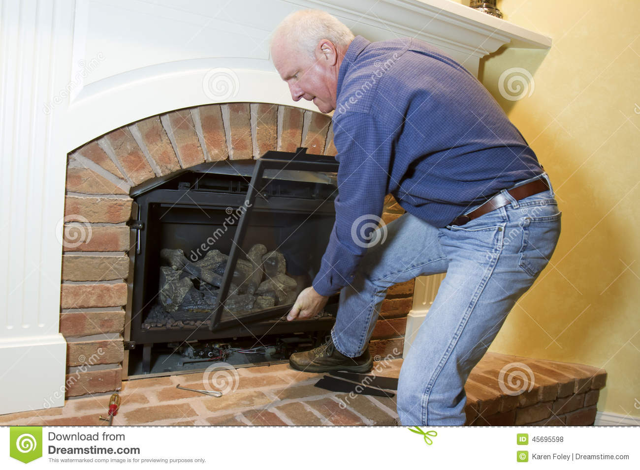 Installation of gas fireplace stock photo image 45695598 for Gas fireplace maintenance do it yourself