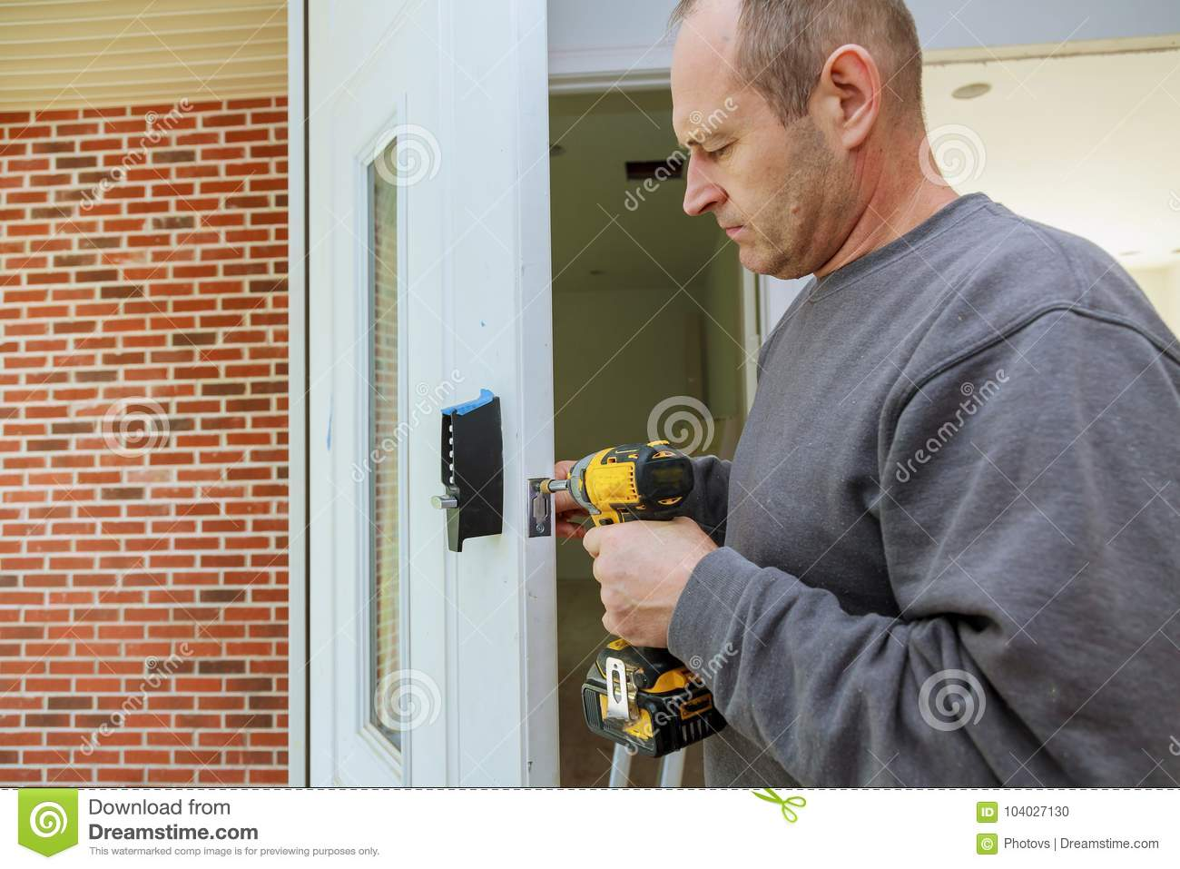 Installation interior door woodworker hands install lock