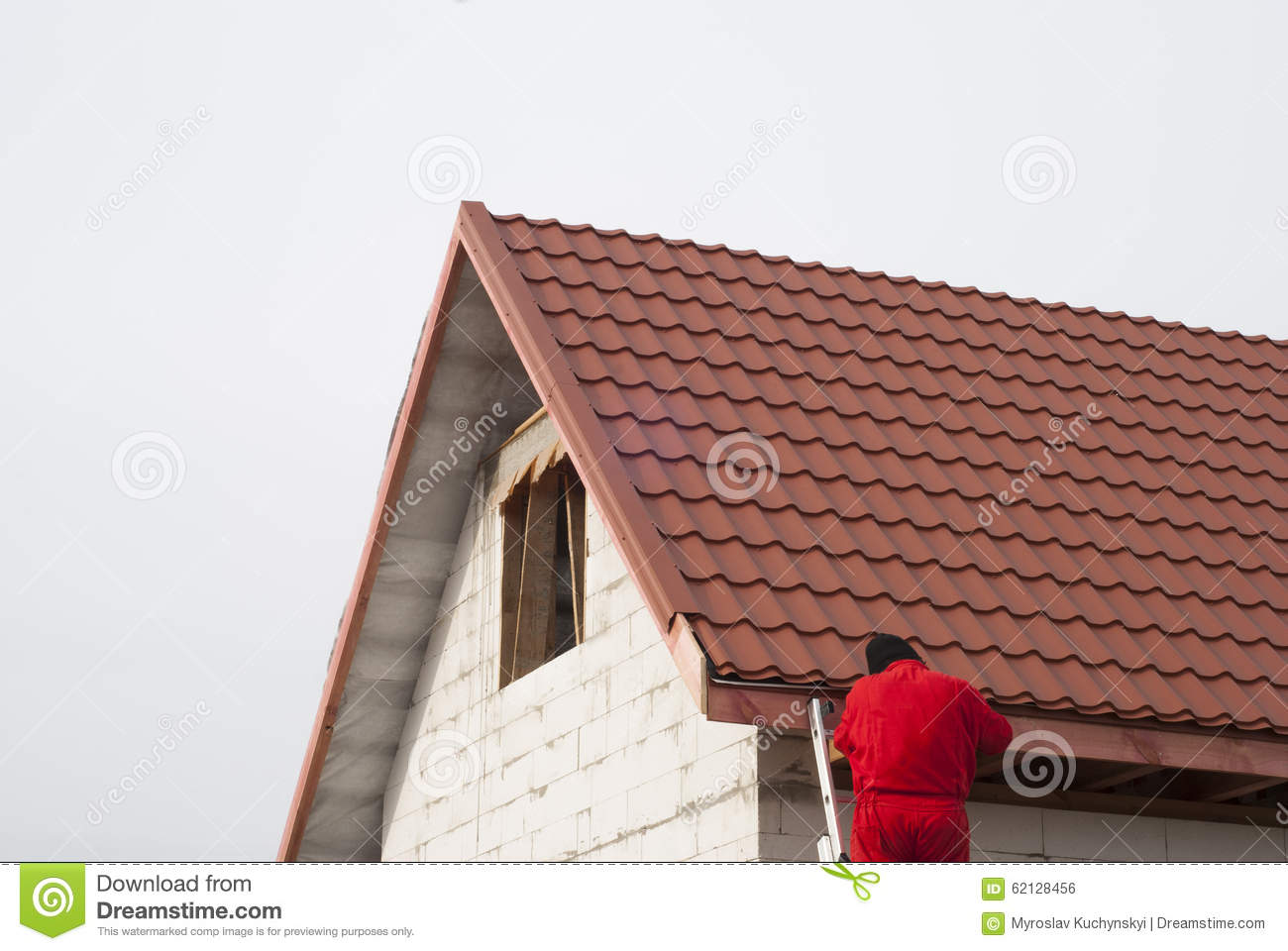 Gable Roof Installation : Installation of a roof stock photo image repairs