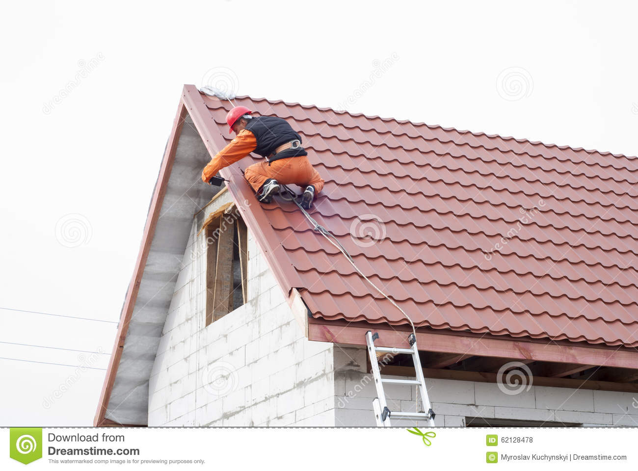 Gable Roof Installation : Installation of a roof stock photo image