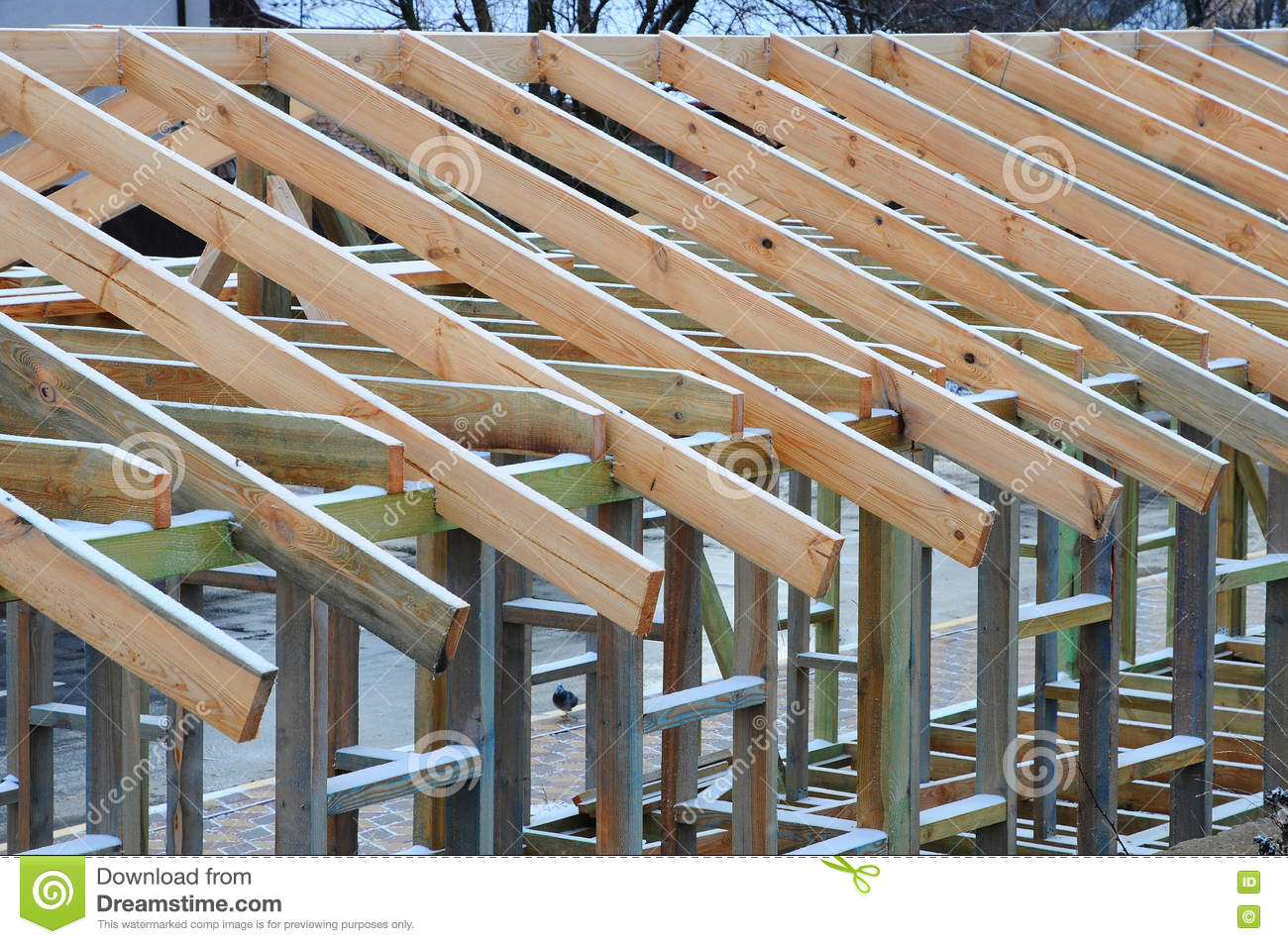 Installation of wooden beams at construction the roof for Roof trusses installation
