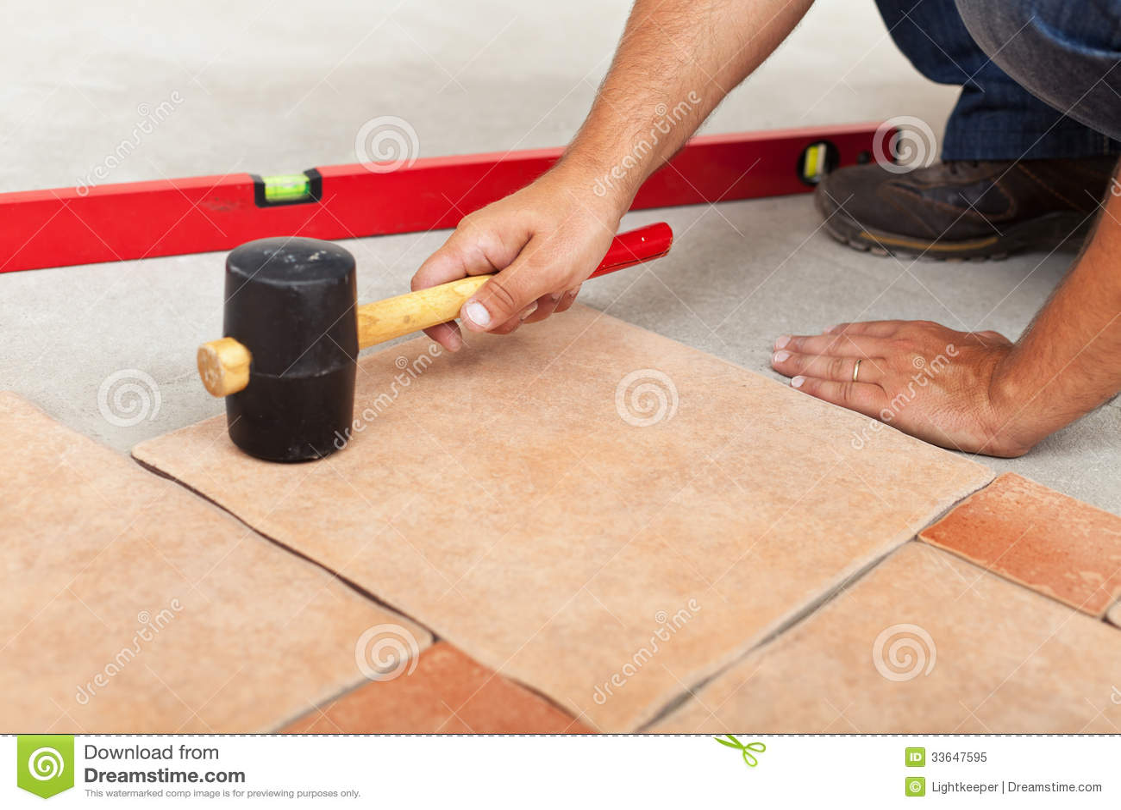 Installing ceramic flooring fitting a tile royalty free for Ceramic floor installation