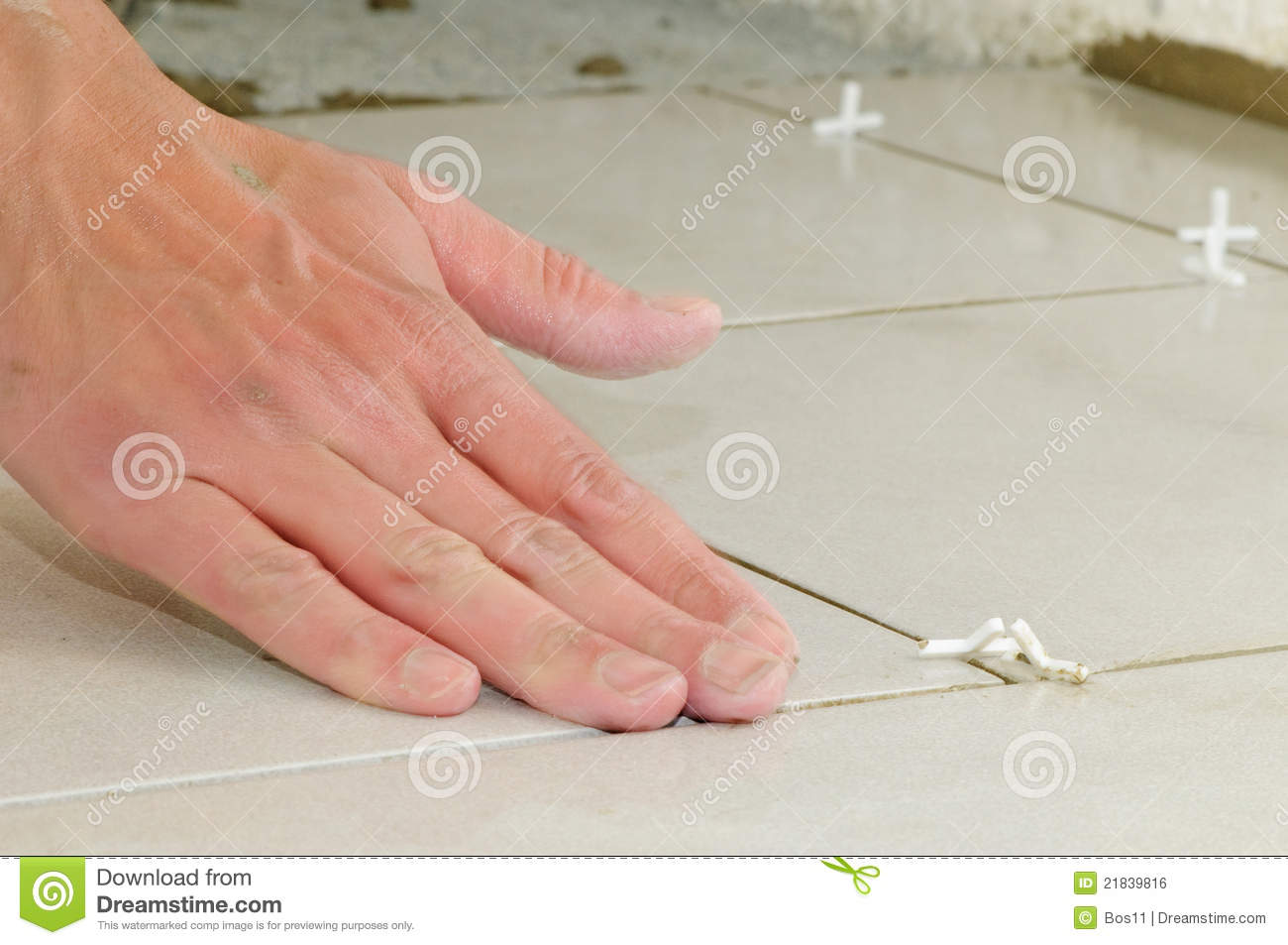 Installing ceramic tile flooring stock photo image 21839816 installing ceramic tile flooring dailygadgetfo Image collections