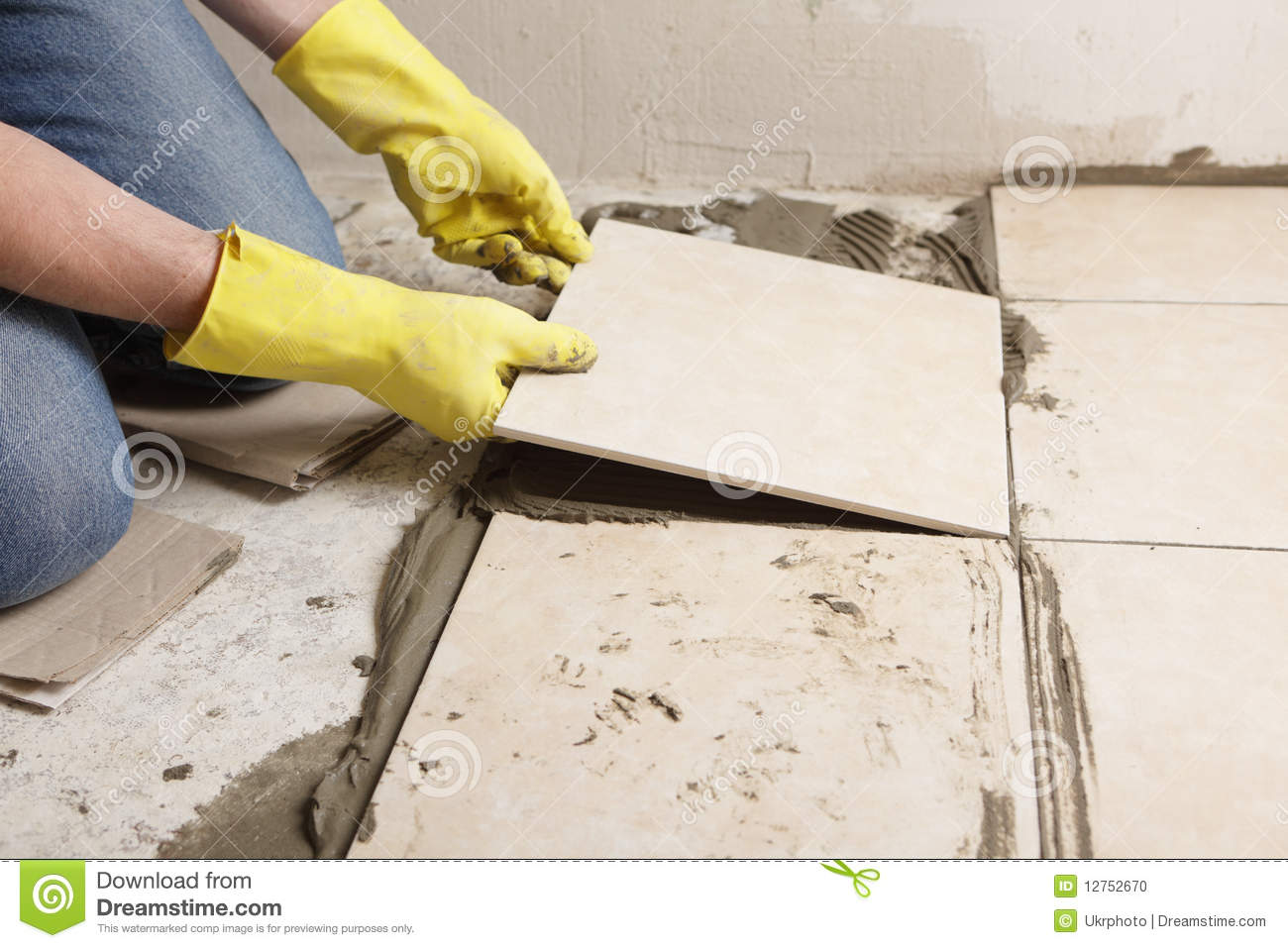Installing Ceramic Tiles On A Floor Stock Photo Image 12752670