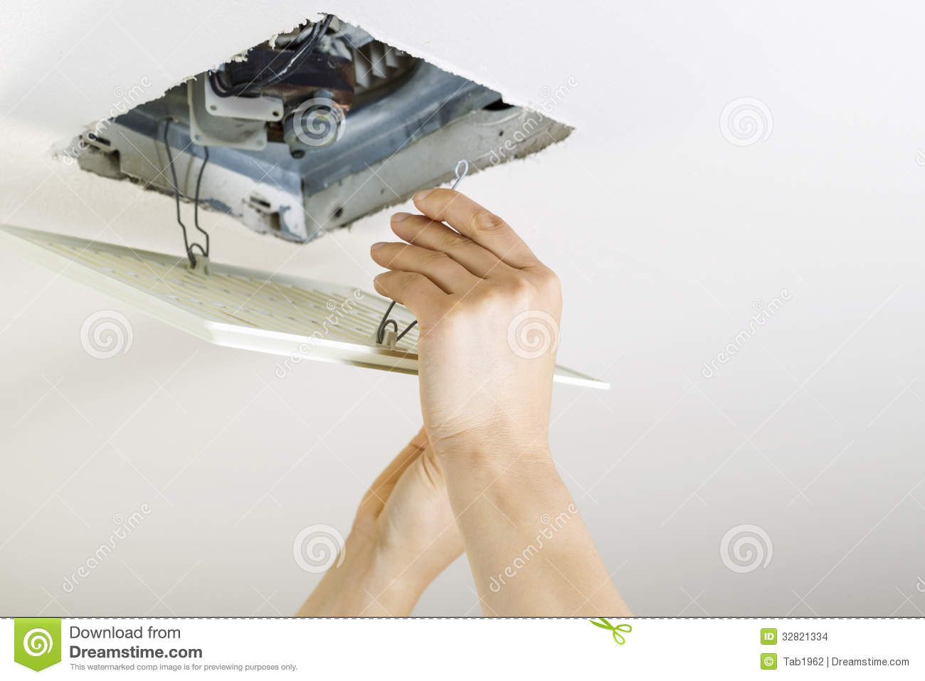 Installing Clean Bathroom Fan Vent Cover Stock Photo