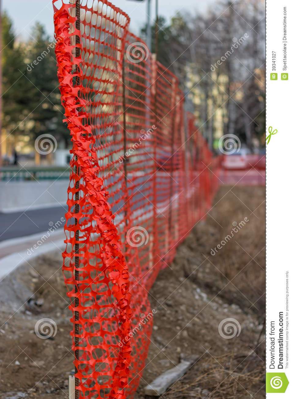 Installing construction mesh safety fence stock photo