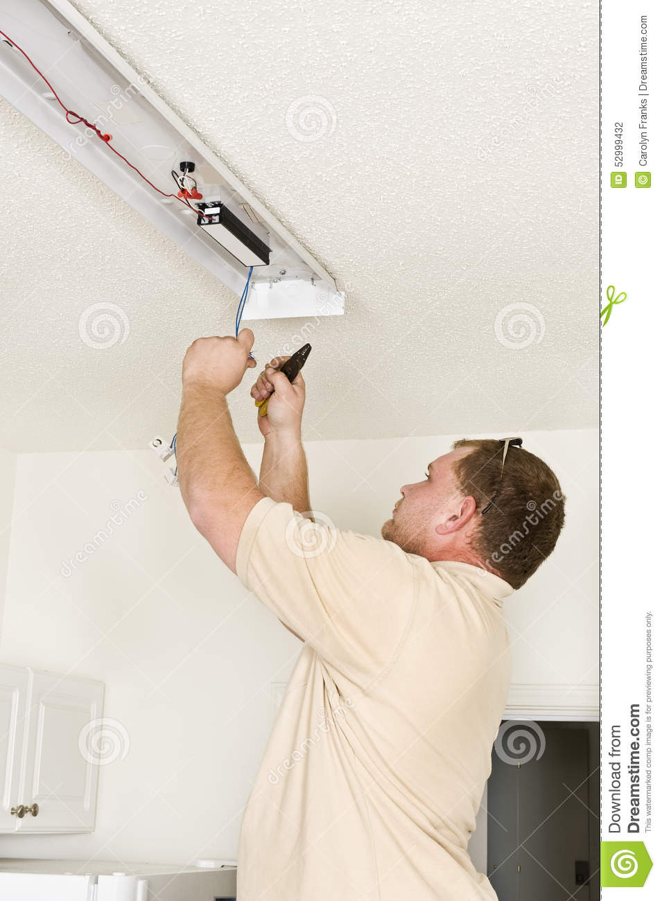 Installing fluorescent lighting fixture stock photo image 52999432 installing fluorescent lighting fixture arubaitofo Image collections