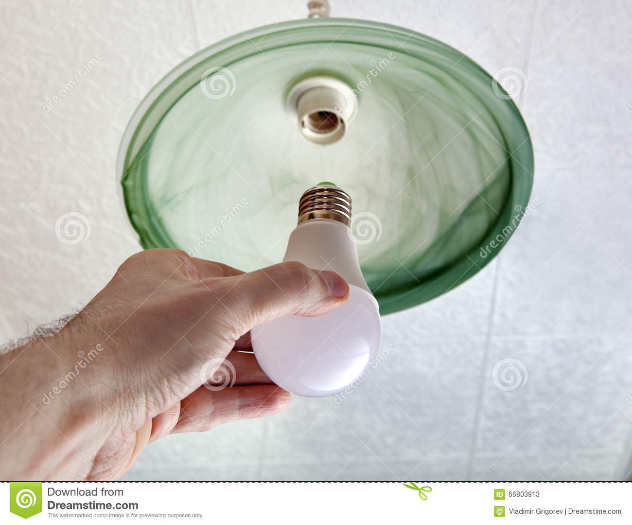 Installing Led Light Bulb In Ceiling Light Hand Holding Lamp Stock Image Image Of Replacement Change 66803913