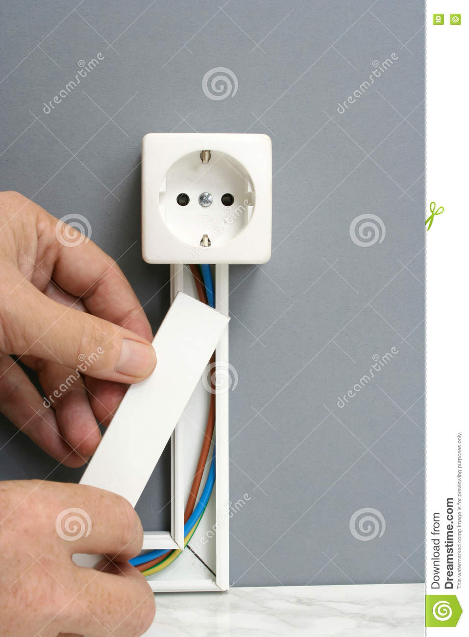 Installing a power outlet with surface mount electric wiring channel