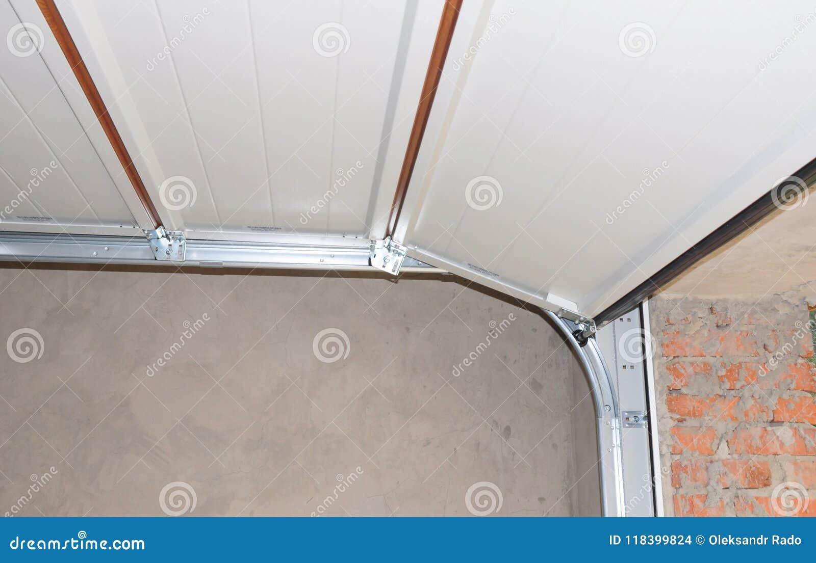 Installing And Repair Garage Door Opener And Lifting System Stock