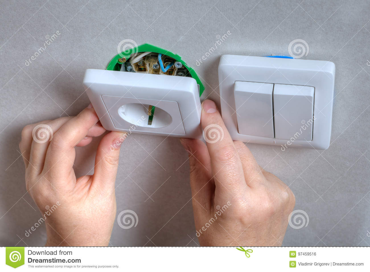 Installing The Wall Outlet Into A Wiring Box Close Up Hands Stock Switch And In Same Download