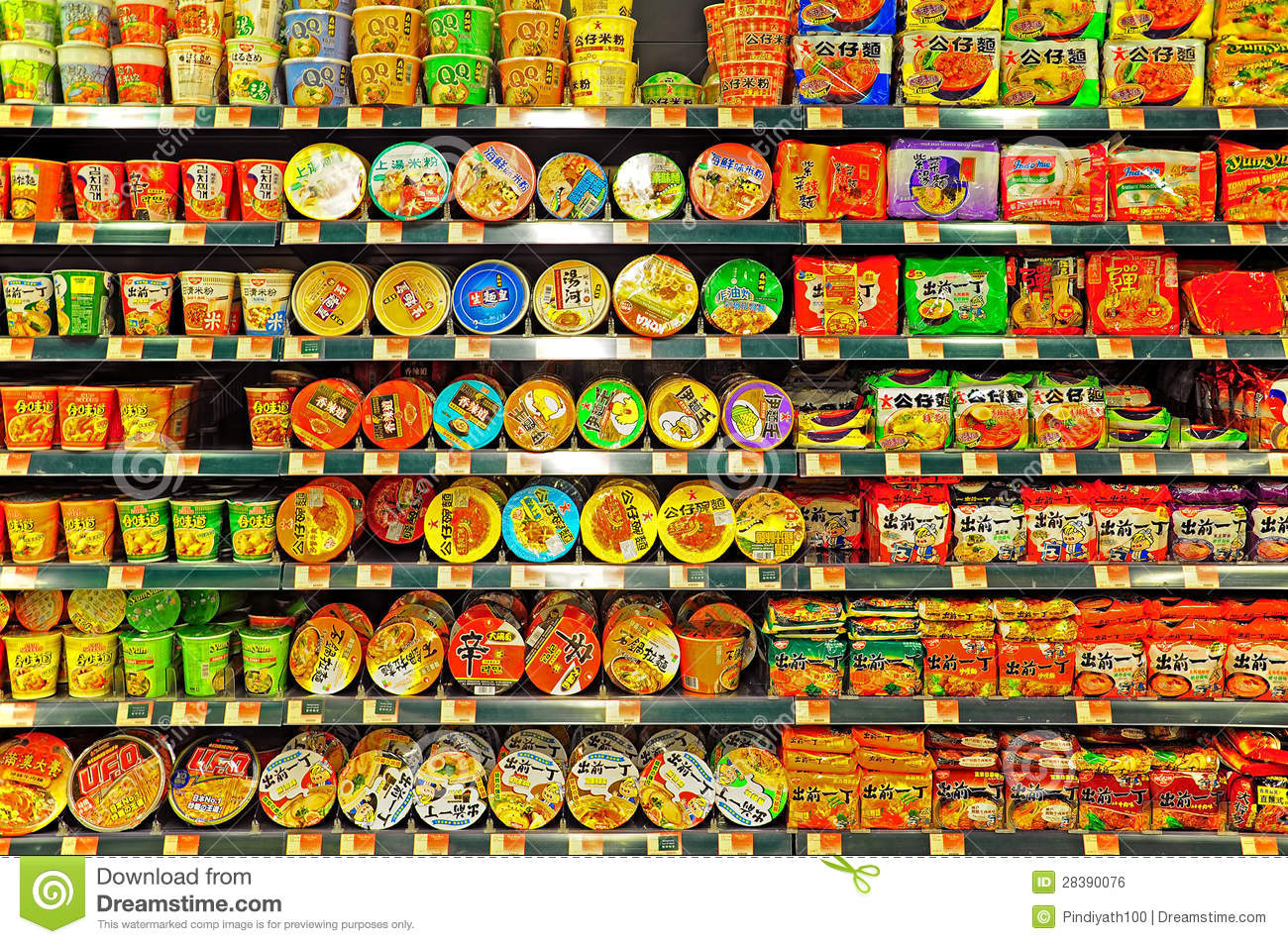 Assortment of flavored instant noodles displayed on shelves at a
