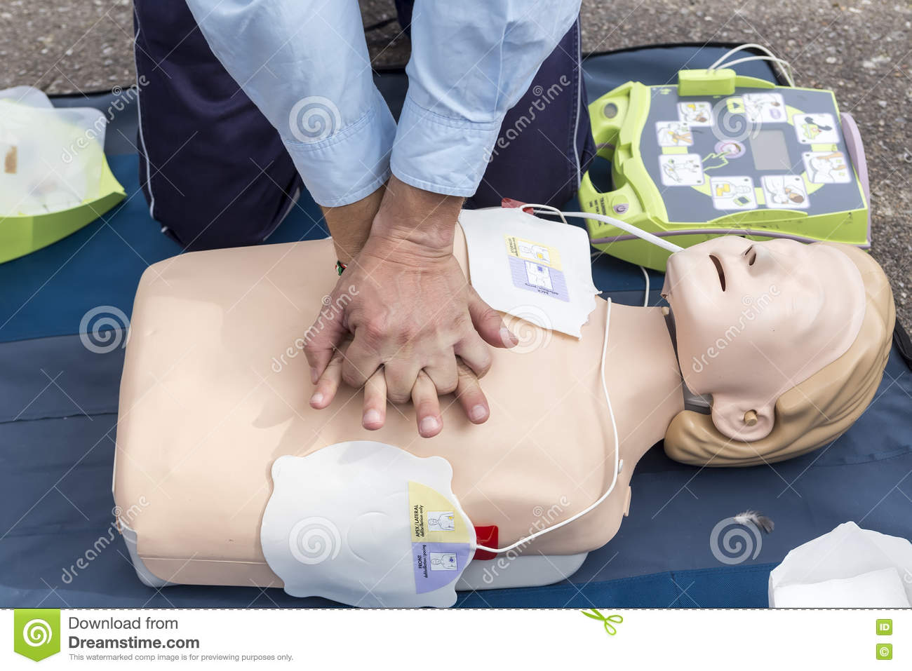 The Instructor Showing Cpr On Training Doll Free First Aid Stock