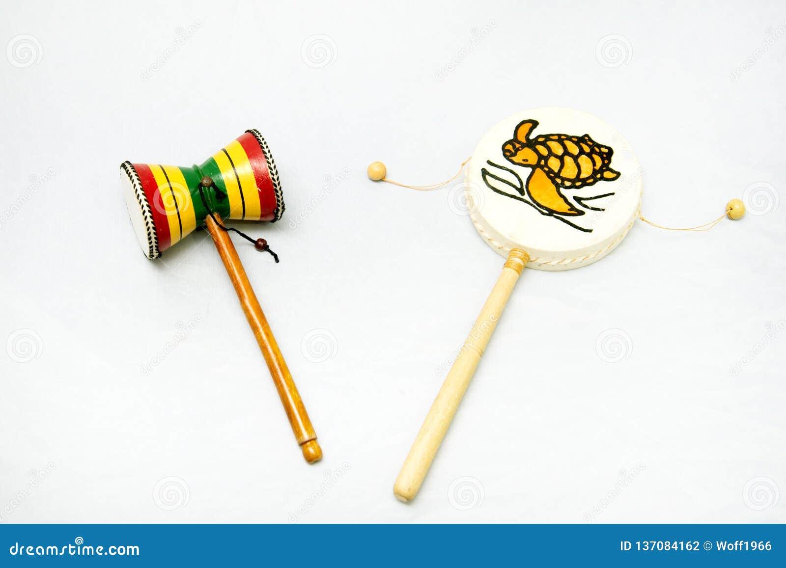 Instrumento musical étnico Instrumento de percussão do cilindro com um punho Damaru