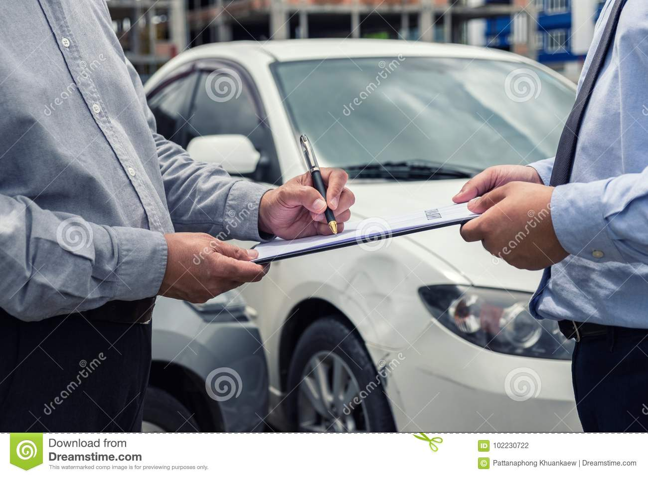 Car Insurance After Accident >> Insurance Agent Examine Damaged Car And Customer Filing