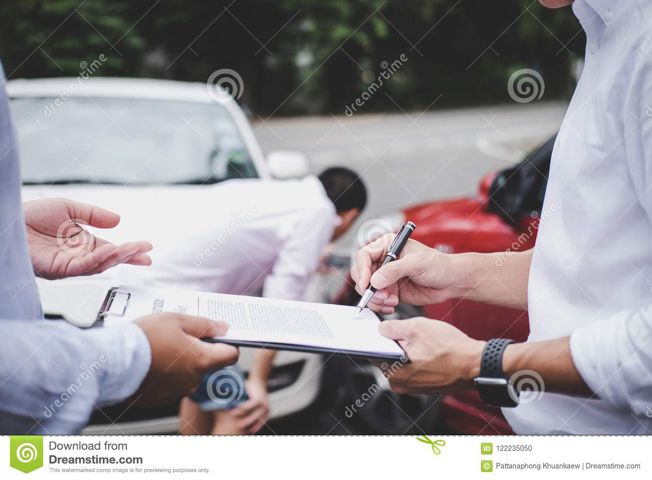 Insurance Agent examine Damaged Car and customer filing signature on Report Claim Form process after accident, Traffic Accident