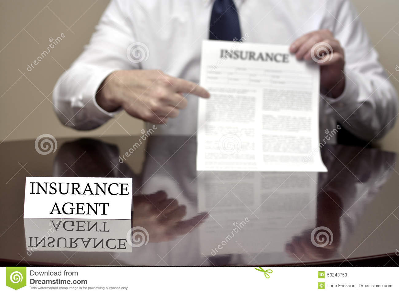 Insurance Agent Holding Insurance Contract Stock Photo