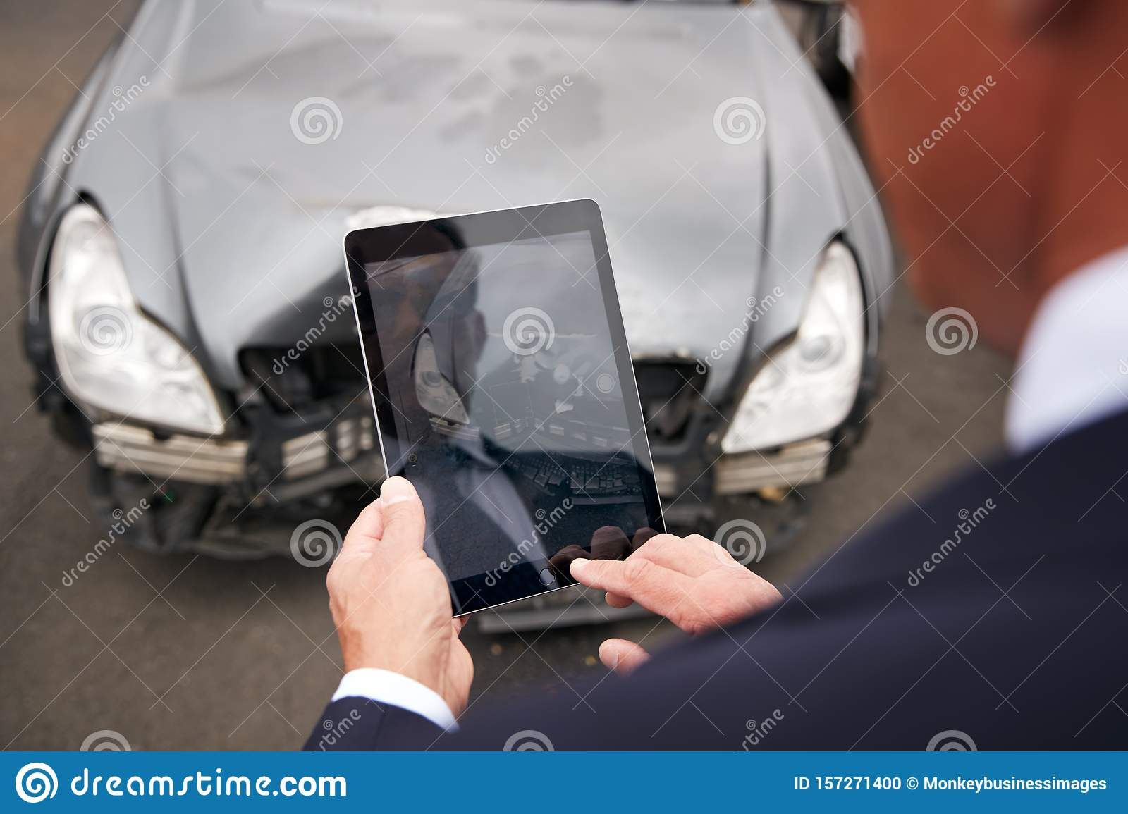 Insurance Loss Adjuster Taking Picture With Digital Tablet ...