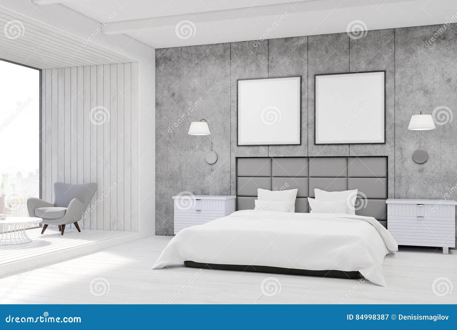 int rieur de chambre coucher avec les murs en b ton un grand lit avec deux affiches carr es. Black Bedroom Furniture Sets. Home Design Ideas