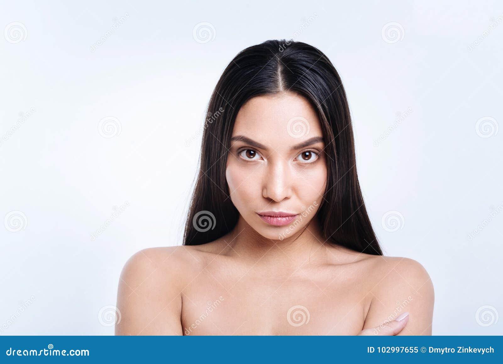 Close Up Of Dark Haired Woman Staring At Camera Stock Image